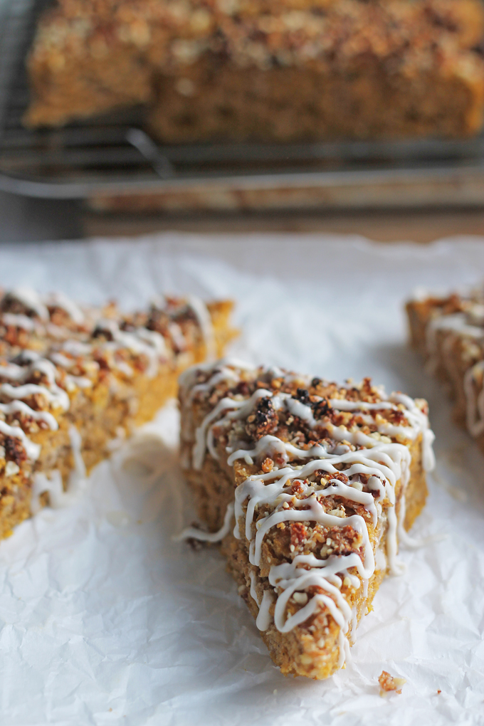 Sliced Vegan Pumpkin Date Bread drizzles with coconut cream.