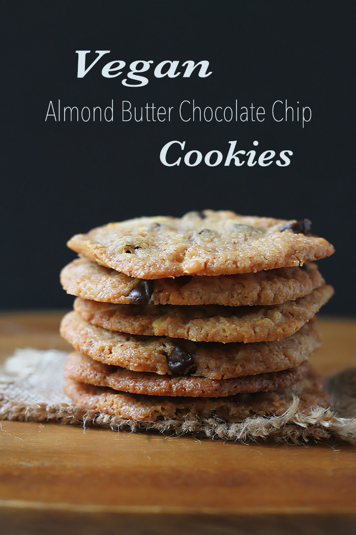 Vegan Almond Butter Chocolate Chip Cookies, thin, crispy, chewy cookies made with almond butter and studded with slivered almonds and dark chocolate chops!