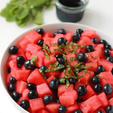Bowl of watermelon blueberry salad with glaze.