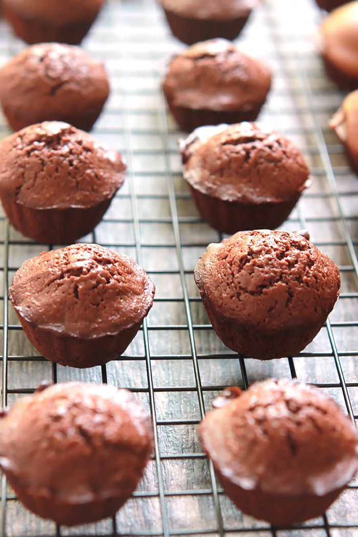 Easy to make two-bite Nut Butter Brownie Bites, topped with an almond butter chocolate glaze. A decadent, delicious, chocolate treat.