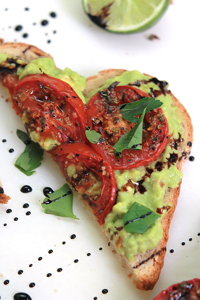Simple, easy and delicious - Roasted Tomato Avocado Toast. Creamy Avocado mash, sweet roasted tomatoes, drizzled with balsamic glaze, it takes toast to a whole new level.
