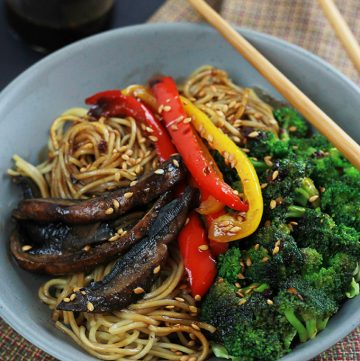 Spicy Ramen Vegetable Stir-Fry in a bowl with red and yellow peppers, mushrooms and broccoli. .