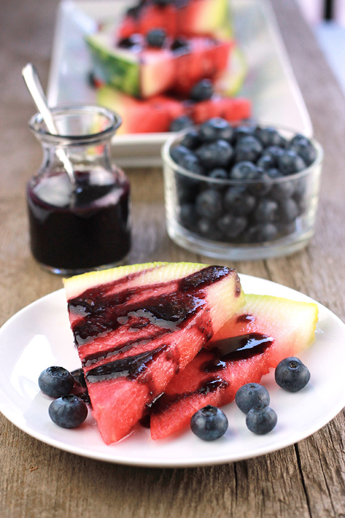 Sweet crisp watermelon drizzled with blueberry glaze, cool things down this summer, serve your guest this simply delicious Blueberry Glazed Watermelon.