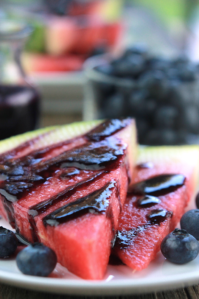 Slices of watermelon drizzled with blueberry glaze.