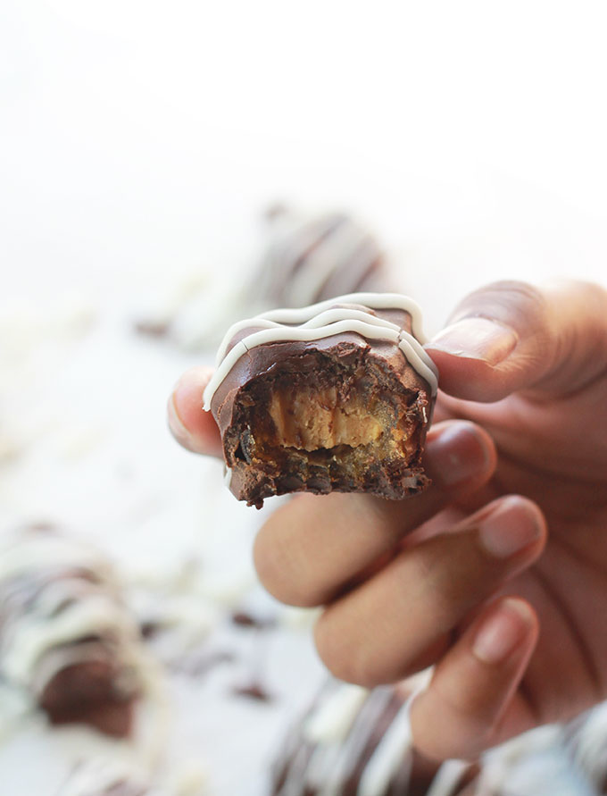 Chocolate Covered Nut Butter Stuffed Date with a bite.