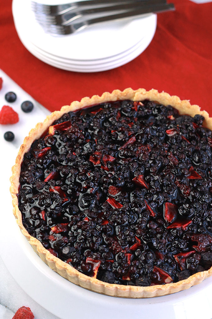Blueberry Raspberry & Apple Tart, topped off with Wild Blueberry Sauce, amazing texture and flavor. Perfect for summer holiday gatherings.