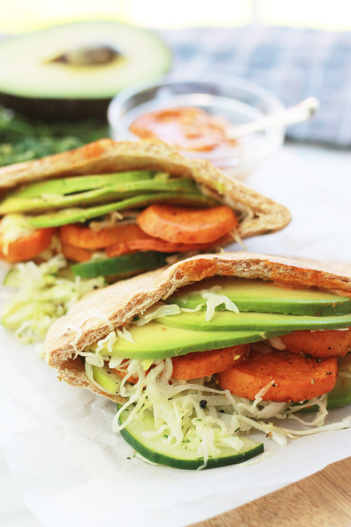 Pita bread stuffed with sliced avocado, sweet potato rounds and cucumber slaw.