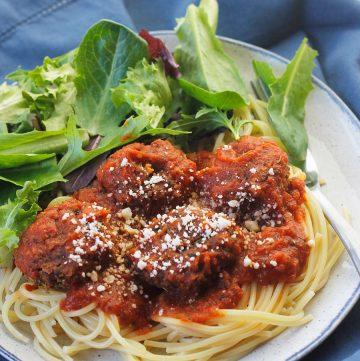 Ovehead angled shot of easy meatless meatball on a bed of pasta and pasta sauce.